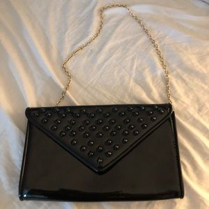 Barely used black aldo purse with gold chain